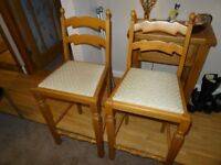 Two breakfast bar stools for sale
