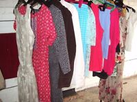 A bundle of approx. 90 pieces of Ladies Clothing including dresses/tops/trs/jackets