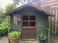 Wooden childs playhouse