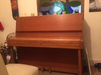 Up right light brown piano