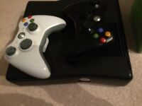 Xbox 360s, 2x controllers, wired charger and 9 games!