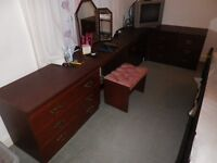 Six darkwood effect draw units, dressing table, corner insert, mirror and stool.