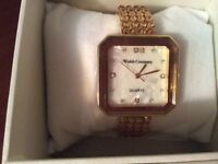 Ladies Gold Coloured Bangle Watch.