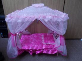 Dolls cot with drapes