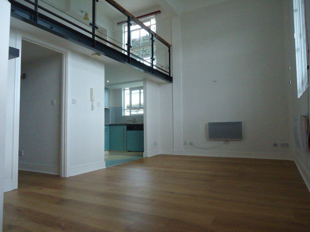 A truly delightful split level loft style apartment on the third floor of this very sought after la