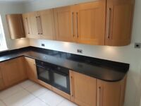 Solid oak kitchen units and granite work tops. Only a few months old.