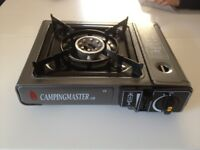 Used camping gas stove with one burner
