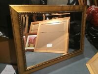 Mirror in brass/ gold effect wood frame