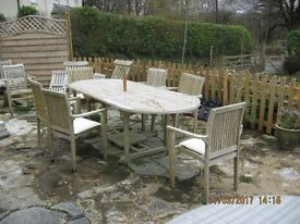 """Teak Garden Table and 6 Stackable chairs and cushions .Table Extended 8' Closed 6' / 3'-3"""" Wide"""