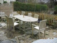 """Teak Garden Table and 5 Stackable chairs and cushions .Table Extended 8' Closed 6' / 3'-3"""" Wide"""