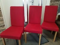 6 red chairs and oak table