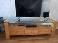 Solid wood TV Cabinet with glass top and 3 drawers. Size: H 55cm. L 1.5m. W 45cm