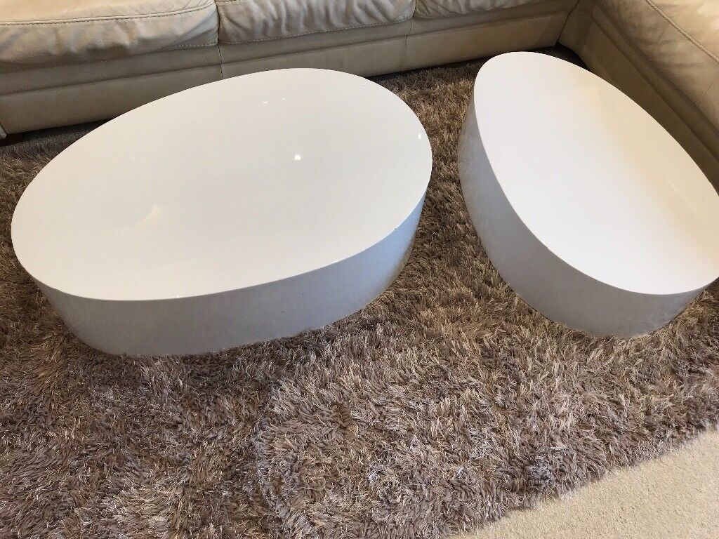 2 high gloss white stackable coffee tables from Dwell