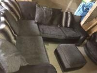 DFS grey & black corner sofa cuddle hair and footstall
