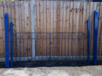 Newly painted driveway gates with large pointed decrotive post ,garden,car,gates,blue,metal
