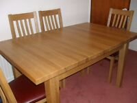 Solid Oak dining table + chairs