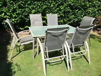 Glass topped garden dining furniture & 6 chairs