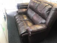 2 x 2 brown leather sofas one a electric recliner
