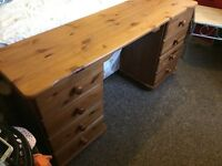 Solid pine study table with 8 drawers.