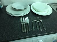 Plates bowls and cutlery