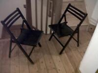 Two black folding chairs