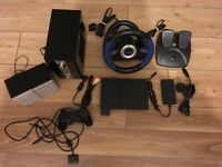 Sony PS2 slim console and 42 games, steering wheel and sound system