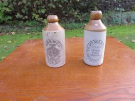 Pair of stoneware ginger beer bottles, good condition.