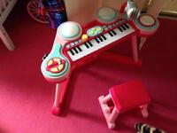 Pink keyboard with stool