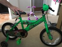 Green dinosaur child's bike
