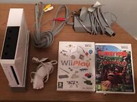 Nintendo Wii Console with Nunchuck and 2 Games Discs (happy to sell individual parts if you prefer)