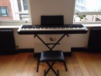 New Casio keyboard, stool and accessories w/ piano weighting