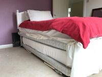 Single divan bed with wooden headboard and trundle bed underneath