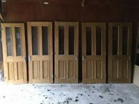 "5 x Oak Doors used (2 solid 2 window panels) 1 x 27"" 4 x 30"""