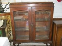 VINTAGE ORNATE GLAZED DISPLAY CABINET. SHIELD STYLE GLAZED DOORS. VIEWING/DELIVERY AVAILABLE