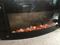 Glass Display coal effect fire with remote control to alter heat settings and fire display