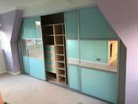 Mirrored sliding doors and shelves