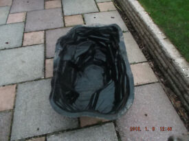Preformed plastic garden fish pond