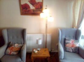 2 high back grey armchairs