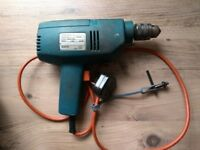 Old Black and Decker drill with cord