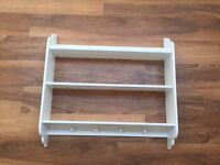White wall hanging shelves with hooks