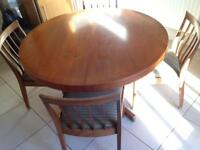 Retro 1960's teak extendable dining table and chairs