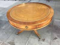 Reproduction drum table with leather top and 4 drawers. Size Diameter 36in Height 21in.