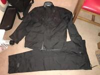 Golf. Black Dunlop golf. Size large. Trousers and jacket.