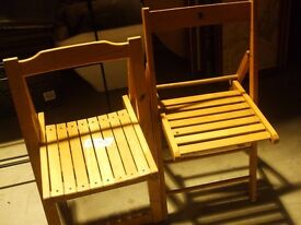two foldaway wooden chairs