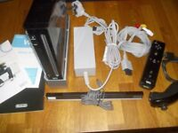 Black Wii Nintendo console with games.