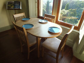 Extendable wooden dining table and 4 chairs