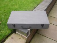 A rectangular wooden tool box with metal handle.