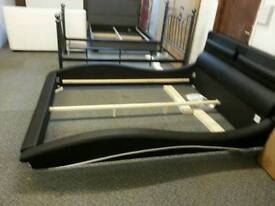 A new black a d white leatherette stylish designer king six bed frame.