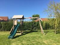 Swing slide and climbing frame