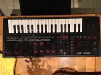 Roland JDXI synth/piano/drum machine.
